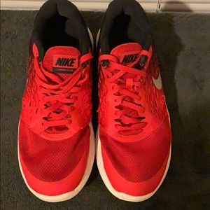 Red and black Nike gym shoes